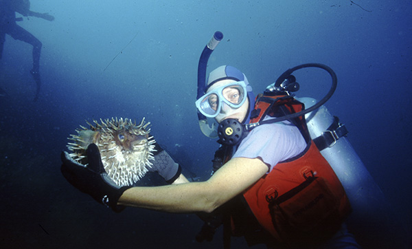 Susan holding a puffer fish. Courtesy Craig Thomas